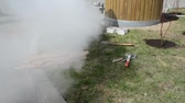 asphalt : man cutting the cement sidewalk tiles with electric cutting tool lot of white dust
