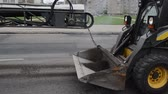 оставаться : Asphalt remains dirt load to small rv truck in street and cars passing. Industrial road repair.