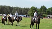 policewoman : NIURONYS, LITHUANIA - JUNE 01: Mounted police horse riders demonstration performance in annual horse festival show on June 01, 2013 in Niuronys, Lithuania. Stock Footage
