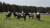 policewoman : NIURONYS, LITHUANIA - JUNE 01: Mounted police horse riders run in circle demonstration performance in annual horse festival show on June 01, 2013 in Niuronys, Lithuania. Stock Footage