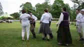 accordionist : KAIRENAI, LITHUANIA - MAY 24, 2014: group of people with national clothes danc folk dances in pairs on May 24, 2014 in Kairenai, Lithuania. Rural communities festival.