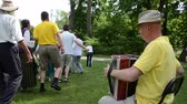 accordionist : KAIRENAI, LITHUANIA - MAY 24, 2014: man musician enjoy play accordion and people dance folk dances in pairs on May 24, 2014 in Kairenai, Lithuania. Rural community festival. Stock Footage