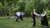 accordionist : KAIRENAI, LITHUANIA - MAY 24, 2014: people dance folk dances in pairs and musician accordionist in park folk event on May 24, 2014 in Kairenai, Lithuania.