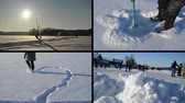 pegada : TRAKAI, LITHUANIA - CIRCA JANUARY 2013 - Ice surfer sail in winter, woman draw heart on snow, icehole drill, people skate on ice on circa January 2013 in Trakai. Montage of footage clips collage Vídeos
