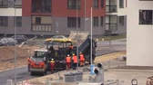 steamroller : VILNIUS, LITHUANIA - NOVEMBER 17, 2014: Asphalt spreader and roller machines on November 17, 2014 in Vilnius, Lithuania. New road construction workers. Static shot on Canon XA25. Stock Footage