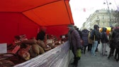 šunka : VILNIUS LITHUANIA  MARCH 06 2015: Woman buy natural freshly smoked meat in spring ecologic organic food fair market on March 06 2015 in Vilnius Lithuania. 4K UHD wide angle shot.