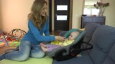 purê : Pretty playful woman feeds son baby at home. Mother put potato mash in infant child mouth at home. 4K UHD video clip.