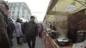 panquecas : VILNIUS, LITHUANIA - MARCH 06: outdoor cafe bake food pancake in large pans and people walk around on March 06, 2015 in Vilnius, Lithuania. 4K UHD wide angle shot. City food fair.