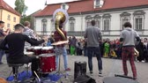 auditório : VILNIUS, LITHUANIA - MAY 16: Charismatic men musician group play wind instruments and drum against big audience on May 16, 2015 in Vilnius, Lithuania. Street music day. Static shot. 4K Stock Footage