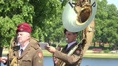 soldado : SIRVINTOS, LITHUANIA - JUNE 29: Military orchestra soldier man in uniform play tuba instrument during city anniversary celebration on June 29, 2015 in Sirvintos, Lithuania. Closeup shot. 4K