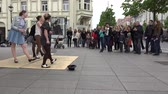 knocking : VILNIUS, LITHUANIA - MAY 16, 2015: People audience applause after young pretty girls women tap step dancers playful performance on May 16, 2015 in Vilnius, Lithuania. Street music day. Static shot.
