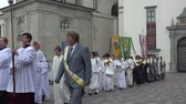 bishop : VILNIUS, LITHUANIA - JUNE 07, 2015: priests and monks carry flags of saints and chant canticle in religious procession near cathedral on June 07, 2015 in Vilnius, Lithuania. Static shot. 4K