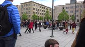 aplauso : VILNIUS, LITHUANIA - MAY 16, 2015: street dancers perform lindy hop dance in pairs with strangers in front of public audience on May 16, 2015 in Vilnius, Lithuania. Street music day. Static shot. 4K