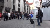 accordionist : VILNIUS, LITHUANIA - MAY 16, 2015: public people audience enjoy young men perform popular music with harmonica accordion instruments on May 16, 2015 in Vilnius, Lithuania. Static. Street music. 4K