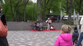 accordionist : VILNIUS, LITHUANIA - MAY 16, 2015: Old man with accordion and drum play music in city square in free event on May 16, 2015 in Vilnius, Lithuania. Street music day. Zoom out shot. 4K Stock Footage