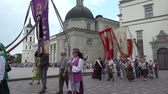 vista : VILNIUS, LITHUANIA - JUNE 07, 2015: Christian religious procession with flags to the city cathedral on June 07, 2015 in Vilnius, Lithuania. 4K UHD video clip.