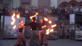 trio : VILNIUS, LITHUANIA - JUNE 19, 2015: woman trio perform modern dance with fire element torch in square for people on June 19, 2015 in Vilnius, Lithuania. 4K UHD video clip.