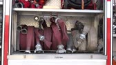 waterhose : VILNIUS, LITHUANIA - MAY 31, 2015: Fire hoses, oxygen cylinders, chain saw and other equipment in a truck to be used by firefighters on May 31, 2015 in Vilnius, Lithuania. Zoom out shot. 4K
