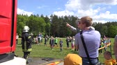 mangueira : VILNIUS, LITHUANIA - MAY 31,2015: Happy children refresh under water from fireman hose cannon on May 31, 2015 in Vilnius, Lithuania. National children day. Static shot. 4K