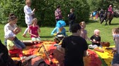 çekmek : SIRVINTOS, LITHUANIA - MAY 29, 2015: children kids play with various musical instruments outdoor on May 29, 2015 in Sirvintos, Lithuania. Static shot. 4K