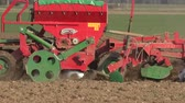 fieldwork : wheat sowing machine in field at autumn time. Panorama view. 4K