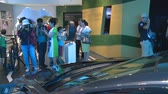 ASTANA, KAZAKHSTAN - July 8, 2017: visitors people taking photos of new hybrid car in Germany pavilion in Expo 2017. Handheld shot Wideo