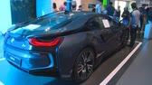 ASTANA, KAZAKHSTAN - July 8, 2017: new hybrid BMW i8 automobile car and people in Germany pavilion in Expo 2017. Handheld shot Wideo