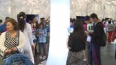 handheld : ASTANA, KAZAKHSTAN - July 8, 2017: lot of visitors people in Korea pavilion in Expo 2017 international exhibition. Handheld panorama shot