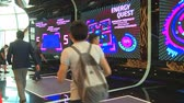 questões : ASTANA, KAZAKHSTAN - July 8, 2017: Men playing energy quest game on fun boards in EXPO 2017 exhibition. Handheld shot. Stock Footage