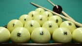 game : billiard balls on the table with the cue