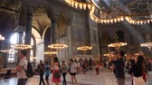 Turkey, Istanbul - 5 June 2019: interior of the old mosque of Hagia Sophia where a large number of tourists go and take pictures on June 5, 2019 Stok Video