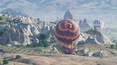 Turkey, Cappadocia - 7 June 2019: folding a large multi-colored balloon standing on the ground on Cappadocia Turkey June 7, 2019 Stok Video