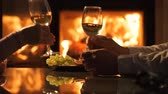 jantar : Young couple have romantic dinner with wine on a fireplace background. Romantic concept.