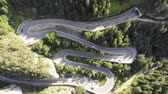 enrolamento : Speeding car on curvy forest road. Road traffic in Bicazului Gorges, Romania