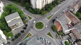 Aerial view of roundabout road and cars.