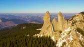 Flying drone above rocky mountain top. Ladys Stones in Rarau mountains, aerial winter view of Rarau top.