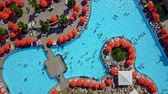 Top view of pools with sun loungers and parasols