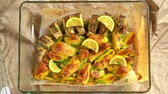 Cooking Baked fish and potatoes, put a lemon. Stok Video