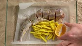 Cooking Fish and potatoes on pan, put lemon
