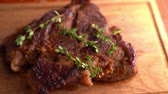 kasap : Cut steak with rosemary with knife closeup Stok Video
