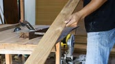cut : carpenter use a planer sliding of wood  in workshop