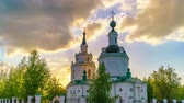 Timelapse of clouds over Russian orthodox church at sunset in russian countryside
