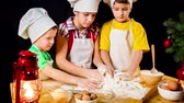 dessert : Three kids kneading the douhg together Stock Footage
