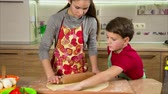 paprika salami : Two kids kneading the dough, making the pizza