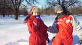 бросать : Two funny kids playing together at snow