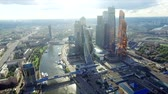 MOSCOW - AUGUST 21, 2016: Aerial view of Moscow-City over Moskva River. Moscow-City (Moscow International Business Center) is a modern commercial district in central Moscow. Vidéos Libres De Droits
