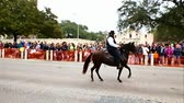 horse gait : San Antonio, Texas USA - February 3 2018: Paso Fino horse and rider go past the historic Alamo during parade celebrating the rodeo