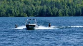 diz : Kneeboarding and speed boat on beautiful northern Minnesota lake on sunny day