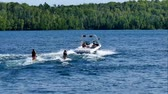 watercraft : Kneeboarding and speed boat on beautiful northern Minnesota lake on sunny day