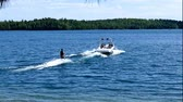 watercraft : Water skier and speed boat on beautiful northern Minnesota lake on sunny day